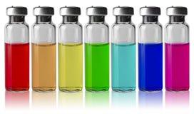 Frascos médicos en fila por espectro de color Foto de archivo libre de regalías