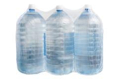 Frascos plásticos com água isolada Fotografia de Stock Royalty Free