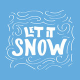 A frase caligráfica escrita mão deixou-a nevar no fundo azul Foto de Stock Royalty Free