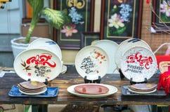 Frase escrita del altavoz arte lunar del Año Nuevo de la cerámica con el ` feliz, mérito, fortuna, longevidad, ` del texto de la  Foto de archivo