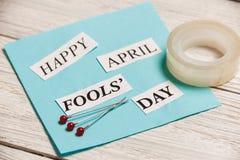 Frase feliz de April Fools Day no fundo de madeira Foto de Stock Royalty Free
