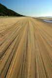 Fraser island australia. Beach road car tyre tracks escape tropical sea lines Royalty Free Stock Photography