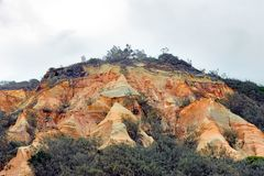 Fraser Island coloured sands, sandy cliffs in orange, red, brown and yellow colors. Coloured sands or pinnacles, a sandstone formation - one of the hot-spots of royalty free stock images
