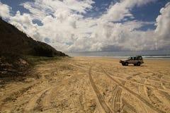 Fraser Island Four Wheel Drive. A four wheel drive vehicle on 75 mile beach.  Fraser Island, Australia Stock Photo