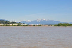 Fraser river with scenic river bank and snow mountains Stock Photography