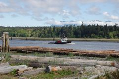 Fraser river tugboat 2. Fraser river tugboat as seen from Iona beach - Vancouver Royalty Free Stock Photography