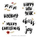 Frases de la caligrafía de la Navidad Elementos drenados mano del diseño Imágenes de archivo libres de regalías