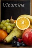 Frash Fruit, Orange, apple, banana, pear, grapes against blackboard Stock Image