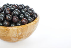 Frash organic black currant in a wooden bowl. Selective focus Stock Images