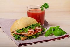 Sandwich with tomato juice royalty free stock photo