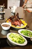 Frasig Peking and med pannkakor Arkivfoto