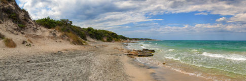 Frassineto beach in Otranto. Panoramic view of Frassineto beach in Otranto in a cloudy day Royalty Free Stock Images