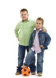 Fratelli con gioco del calcio Fotografia Stock Libera da Diritti