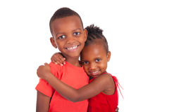 Bambini felici attivi che saltano con la gioia fotografia - Fratello e sorella a letto insieme ...