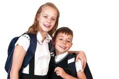 Fratello e sorella, scolari felici Fotografie Stock Libere da Diritti