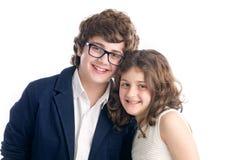Fratello e sorella sparati su bianco Immagini Stock Libere da Diritti