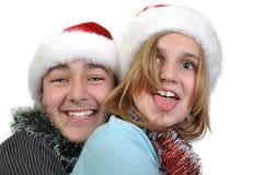 Fratello felice e sorella che celebrano il Natale immagine stock libera da diritti