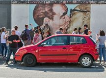 Fraternal Kiss Honecker - Brezhnev in Berlin, Germany. BERLIN, GERMANY - APRIL 19, 2019: People visit East Side Gallery with famous graffiti painting Fraternal royalty free stock photo