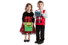 Fraternal twins with Christmas presents. Portrait of 3 year old fraternal boy and girl twins holding Christmas presents isolated on white background Stock Photography