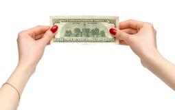 Frau übergibt Holdingdollar Lizenzfreie Stockbilder