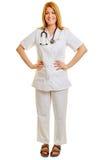 Frau als Doktor oder Krankenschwester mit den Händen auf ihren Hüften Stockbilder