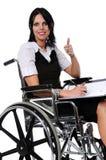 Frau auf dem Rollstuhl, der Bestimmtheit ausdrückt Lizenzfreie Stockfotografie
