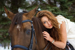Frau auf einem Pferd Lizenzfreie Stockfotos