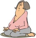 Frau auf ihren Knien meditierend Stockfoto