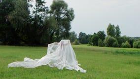 Frau bedeckt mit Plastik in der Natur stock video footage