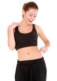 Frau überprüft die Taillenfettheit auf Weiß Lizenzfreies Stockfoto