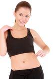 Frau überprüft die Taillenfettheit auf Weiß Lizenzfreie Stockfotografie