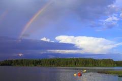 Frau canoeing Stockbild