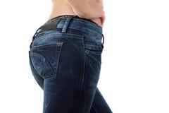 Frau in den festen Jeans Lizenzfreies Stockbild
