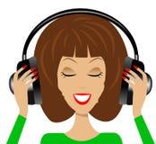 Frau in den Kopfhörern auf einem weißen Hintergrund Lizenzfreie Stockbilder