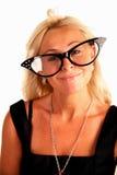 Frau in den lustigen großen Gläsern Lizenzfreie Stockbilder