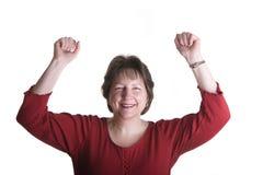 Frau in den roten Fäusten in der Luft Stockfotos