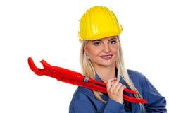 Frau in der blauen Arbeit Stockbild