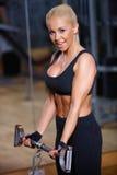 Frau an der Gymnastik Lizenzfreies Stockfoto