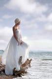Frau an der Küste Stockbilder