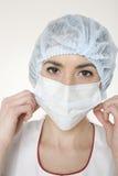 Frau in der medizinischen Maske Stockfotografie