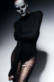 Frau in der schwarzen heftigen Strumpfhose und in der Spitze Lizenzfreies Stockfoto