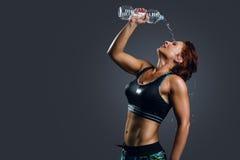 Frau in der Sportkleidung Stockfotos