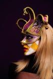 Frau in der violetten halben Schablone Lizenzfreies Stockbild