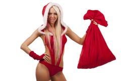 Frau in der Weihnachtsmann-Klage mit Geschenkbeutel Lizenzfreie Stockfotos
