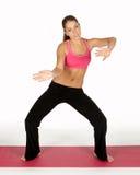 Frau in der Yoga-Haltung Lizenzfreies Stockfoto