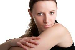 Frau, die über ihrer Schulter schaut Stockbilder