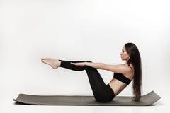 Frau, die Übungen tut Stockfotos