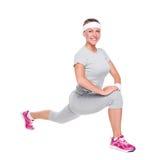 Frau, die Übungen und das Lächeln tut Stockbild