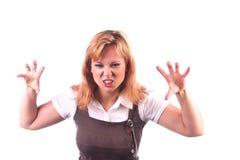 Frau, die aggressiv oder furchtsam schaut Lizenzfreie Stockfotografie
