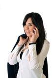 Frau, die auf dem Telefonlächeln spricht Stockbilder
